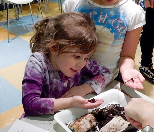 Child with touch tank